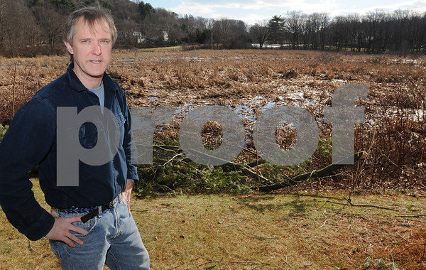 Hamilton:<br /> Preston Ward speaks about the encroaching wetlands near the edge of his property which are behind him.<br /> Photo by Ken Yuszkus/Salem News, Monday December 29, 2008.