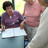 Peabody:<br /> Betty Quinlan, party chairman, left, and Kay Morrocco, president, sell tickets to the upcoming 50th anniversary of the Golden Age Club in Peabody to be held at the Danversport Yacht Club. <br /> Photo by Ken Yuszkus/Salem News, Wednesday, July 18,  2012.