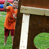 Salem:<br /> Xavier Valdez, 9, throws a football toward the holes in the football toss game during the Fourth of July activities at the Palmer Cove playground.<br /> Photo by Ken Yuszkus/Salem News, Wednesday, July 4,  2012.