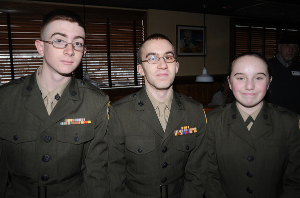 Peabody:<br /> From left, Zack Dunham, Arthur Jacobs, and Emily Sylvester, all of Beverly High School, gather at a luncheon at Outback Steakhouse to drum up support for Operation Homefront, a troop-support organization.<br /> Photo by Ken Yuszkus/Salem News, Wednesday, March 3, 2010.