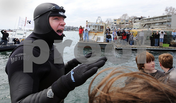 Marblehead:<br /> Chris Swain gives a speech before starting his swim. The Marblehead man is swimming to Washington D.C. to help environment.<br /> Photo by Ken Yuszkus/Salem News, Wednesday, April 22, 2009.
