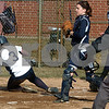 Wenham:<br /> Katherine McGann of Endicott College, safely slid into home plate for the first run of the game at the Gordon vs. Endicott College softball game at Gordon College. Gordon College catcher Courtney Stevenson watches the field as Katherin McGann slid in.<br /> Photo by Ken Yuszkus/Salem News, Friday, March 27, 2009.