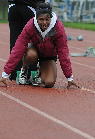 Beverly:<br /> Salem's Jasmine Bryant at the starting blocks as she warms up for the hurdles during the Salem at Beverly track meet.<br /> Photo by Ken Yuszkus/Salem News, Tuesday, May 17, 2011.