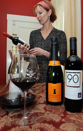 Swampscott:<br /> Maia Gosselin has started a business in which she holds wine tastings for people at their homes, to introduce them to new wines. <br /> Photo by Ken Yuszkus/Salem News, Friday,  February 24, 2012.