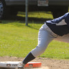 Peabody:<br /> Peabody's Olivia Brothers dives back to first safely as Swampsott's Bridget Geno-Wong gets the throw from the catcher at the Swampscott at Peabody in Northeastern Conference softball game.<br /> Photo by Ken Yuszkus/Salem News, Monday, May 7, 2012.