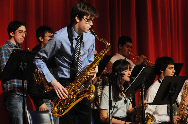 Salem:<br /> Jackson Martel plays a solo on the saxaphone. He was on stage with the Salem High School Jazz Band playing tunes for the AARP Chapter 2454 meeting in the Salem High School auditorium on Friday afternoon.<br /> Photo by Ken Yuszkus/Salem News, Friday, January 7, 2011.
