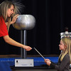 Wenham:<br /> Noelle Perry, left, from the Museum of Science, holds onto the Van de Graaf generator and creates a spark as she transfers an electrical charge to a titanium rod held by Amanda Blanchard, 3rd grade student. Noelle presented her program on electromagnetism to the 3rd, 4th, and 5th graders at the Buker Elementary School on Wednesday morning.<br /> Photo by Ken Yuszkus/Salem News, Wednesday, November 2, 2011.