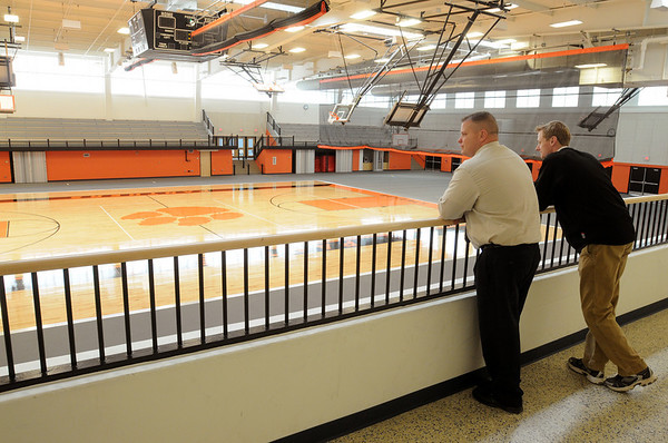 Beverly:<br /> Principal Sean Gallagher, left, and James Coffey, atheletic director, stand near the balcony overlooking Beverly High School's renovated field house.<br /> Photo by Ken Yuszkus/Salem News, Monday, May 9, 2011.