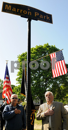 Peabody:<br /> Bobby Marron, left, and Russ Marron, brothers of fallen Army PFC, Bruce Allan Marron for whom Marron Park is now named stand near the sign which was just unveiled during a brief ceremony.<br /> Photo by Ken Yuszkus/Salem News, Monday May 11, 2009.