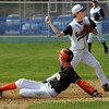 Hamilton:<br /> Ipswich's Mark Gallant is safe on second base as Hamilton-Wenham's Ryan Ropes throws to first base, during the Ipswich at Hamilton-Wenham baseball game at Patton Park.<br /> Photo by Ken Yuszkus/Salem News, Thursday, April 22, 2010.