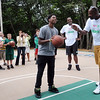 """Salem:<br /> Diarra Pickett, one of the boys from the Plummer Home for Boys, left, gets advice from former Celtic, Cedric Maxwell, as Diarra gets ready to shoot for the basket. Celtic's Glen """"Big Baby"""" Davis stands in the background between the two. Glen """"Big Baby"""" Davis and Cedric Maxwell were at the Plummer Home for Boys for the dedication of the basketball court that the Celtics helped build along with the NFL quarterback Steve Young's Foundation. They also shot a few hoops with the kids.<br /> Photo by Ken Yuszkus/Salem News, Monday August 16, 2010."""