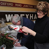 Salem:<br /> Bonnie Adams examines an item before placing a silent bid at the Salem Children's Charity Annual Christmas Party held at Victoria Station restaurant.<br /> Photo by Ken Yuszkus/Salem,  News, Tuesday,  December 14, 2010.
