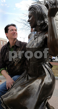 Salem:<br /> Mark Wood, plans to open a Bewitched museum and B&B in downtown Salem. He is standing near the Bewitched statue at the corner of Washington Street and Essex Street..<br /> Photo by Ken Yuszkus/Salem News, Friday, April 10, 2009.