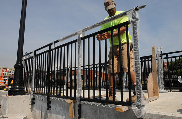 Salem:<br /> Kevin Pelletier installs a section of fencing along the Harbor Walk. Harbor Walk will open on Thursday with a ribbon cutting ceremony. <br /> Photo by Ken Yuszkus/Salem News, Tuesday, July 13, 2010.