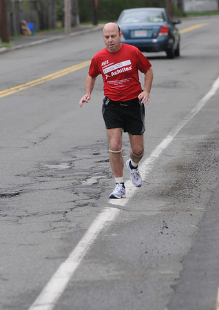 """Beverly:<br /> Kevin Counihan is a """"mobility impaired"""" runner who will be tackling his 100th marathon in 7 1/2 years on Monday at Boston. Counihan has already run seven Boston Marathons, and he believes he holds the world record for most marathons run by a """"mobility impaired"""" runner.<br /> Photo by Ken Yuszkus/Salem News, Friday, April 16, 2010."""