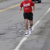 "Beverly:<br /> Kevin Counihan is a ""mobility impaired"" runner who will be tackling his 100th marathon in 7 1/2 years on Monday at Boston. Counihan has already run seven Boston Marathons, and he believes he holds the world record for most marathons run by a ""mobility impaired"" runner.<br /> Photo by Ken Yuszkus/Salem News, Friday, April 16, 2010."