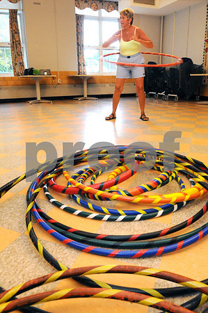 Ipswich:<br /> Irene Van Schyndel, instructor, leads with her hula hoop during the weekly women's hula hoop session in the Senior Center in town hall. Various colored hula hoops that she owns lay on the floor in the foreground.<br /> Photo by Ken Yuszkus/Salem News, Monday, August 10, 2009.
