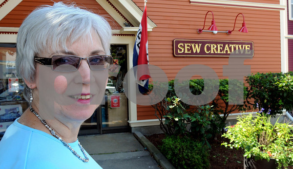 Beverly:<br /> Phyllis Vray, owner of Sew Creative, stands in front of her business.<br /> Photo by Ken Yuszkus/Salem News, Friday, September 4, 2009.