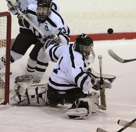Peabody:<br /> Peabody's goalie Derek Savage keeps an eye on the flying puck near his net during the Bishop Fenwick vs Peabody 24th annual Carlin Cup hockey game at the McVann-O'Keefe Rink in Peabody.<br /> Photo by Ken Yuszkus/Salem News, Monday, February 21, 2011.