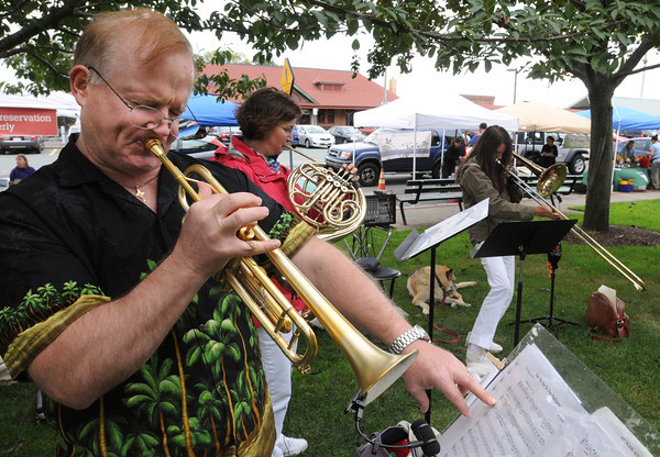 Beverly:<br /> Quintessential Brass Quintet members from left, Mike Peipman, Robin Milinazzo, and Leslie Havens play their music at the Beverly Farmers' Market on Monday. Also members of the band are Alan Johnson and Leenie Doran.  <br /> Photo by Ken Yuszkus/The Salem News, Monday, September 10, 2012.