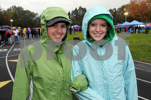 Danvers:<br /> Meghan Harris, left, and Melanie Duignan were part of the crowd of walkers preparing to start on their 3-mile walk in the rain during the 22nd Annual Walk for Hospice from Cronin Memorial Stadium at St. John's Prep.<br /> Photo by Ken Yuszkus/Salem News, Sunday October 18, 2009.