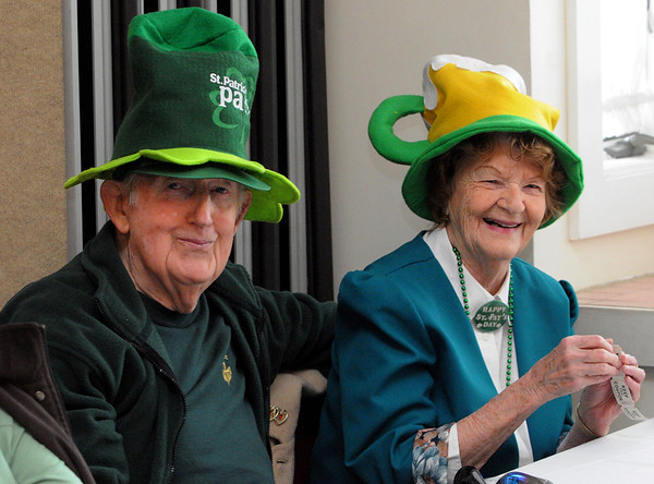 Beverly:<br /> Bob Donaher and Grace Orner wear their party hats during the St. Patrick's Day party at the Beverly Senior Center.<br /> Photo by Ken Yuszkus/Salem News, Thursday,  March 15, 2012.