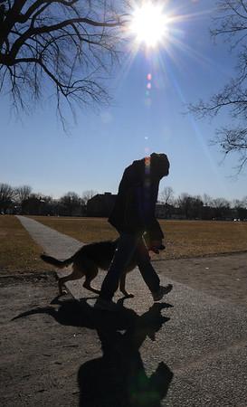 Salem:<br /> Francine Thornhill of Salem, walks her german shepard, Hope, around the Salem Common on a clear blue sky morning.<br /> Photo by Ken Yuszkus/Salem News, Thursday, February 9, 2012.