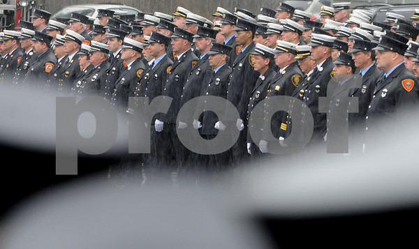 Beverly:<br /> Firefighters from various cities and towns stand at attention as the family of Beverly firefighter Paul Roberts enter Immanuel Congregational Church for his funeral.<br /> Photo by Ken Yuszkus/Salem News, Friday May 29, 2009.