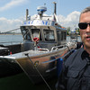 Salem:<br /> Bill McHugh, Salem's harbormaster, has just finished his first year on the job. He is standing near Salem's newest boat, which is one of four.<br /> Photo by Ken Yuszkus/Salem News, Friday, July 6,  2012.