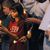 Ipswich:<br /> Jenna Nichols holds a candle, along with others, during the vigil held for Tony Woo at the center of town. Woo, owner of the Majestic Dragon restaurant on Route 1, was found dead on Tuesday, Sept. 27.  He was well-known and well-liked by folks in Ipswich.<br /> Photo by Ken Yuszkus/Salem News, Monday, October 3, 2011.