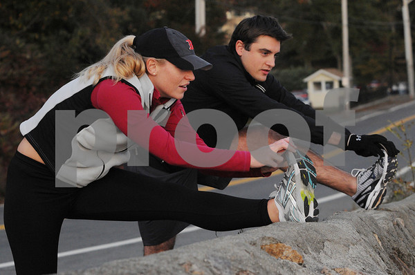 Beverly:<br /> Dan Ritchie and Eileen Moschella are training for the New York City Marathon.<br /> Photo by Ken Yuszkus/Salem News, Monday October 19, 2009.
