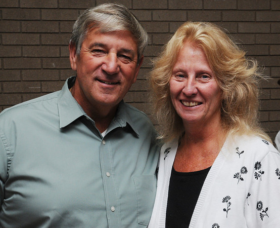 Beverly:<br /> Jim McHugh, former athletic director at Bishop Fenwick High School and his wife Erin McHugh attend Mike's retirement reception at the Salem News on Thursday evening.<br /> Photo by Ken Yuszkus/Salem News, Thursday, September 8, 2011.