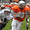 Beverly:<br /> Beverly's Rashad Sims outruns Swampscott's Mike DePippo in the first quarter at the Swampscott at Beverly football game on Saturday.<br /> Photo by Ken Yuszkus/Salem News, Saturday, November 8, 2008.