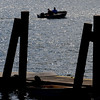 Salem:<br /> The sun sparkles on Salem Harbor as boaters cruise by the wharf at Winter Island.<br /> Photo by Ken Yuszkus/Salem News, Tuesday,  September 14, 2010.