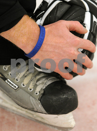 Hamilton:<br /> Tom Smith shows the bracelet he wears. He is selling bracelets to raise money for the Miami Project. He was a former Pingree hockey player, and had a terrible accident while playing junior hockey after getting out of high school.<br /> Photo by Ken Yuszkus/Salem News, Friday, April 3, 2009.