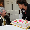 Salem:<br /> Marion Garfinkel, left, is surprised by the cake that Sharon Doucette presented to her for over 50 years in nursing. The event was held on National Nurses Day on Friday at Grosvenor Park Nursing Center.<br /> Photo by Ken Yuszkus/Salem News, Friday, May 6, 2011.