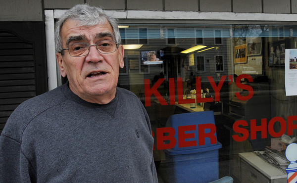 Salem:<br /> Achilles Xerras, owner of Killy's Barber Shop, talks about  the construction on Bridge Street and how it has impacted his buisness.<br /> Photo by Ken Yuszkus/Salem News, Monday, April 4, 2011.