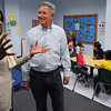 Salem:<br /> Leoncia Sierra, program director, of Salem Community Child Care, and David Baer of GT Crystal Systems, talk in the class for after school kindergarten students at Salem Community Child Care.<br /> Photo by Ken Yuszkus/Salem News, Wednesday, April 25, 2012.