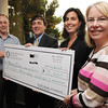 Danvers:<br /> Brad Gaige, left, president of the Rotary Club of Beverly, presents a check for $15,000 dollars to the Beverly Children's Learning Center. Accepting the check, from the Beverly Children's Learning Center, are from left, David Ray, Miranda Gooding, both board members, and Deborah Walker, staff member. The meeting of the Rotary Club of Beverly took place at the Danversport Yatch Club.<br /> Photo by Ken Yuszkus/Salem News, Thursday, May 6, 2010.