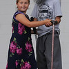 Beverly:<br /> Annamarie Kozlowski, 6, left, and Aidan O'Shea, 9, dance on the stage as senior citizens at Lynch Park during the musical presentation from Balch Playground during the Beverly Homecoming's annual Lip Sync Extravaganza. <br /> Photo by Ken Yuszkus/Salem News, Tuesday, August 2, 2011.