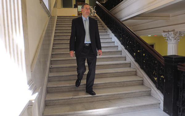 Boston:<br /> Jerry Parisella walks down a stairway on his way to an appoimtment at the state capitol.<br /> Photo by Ken Yuszkus/Salem News, Wednesday, April 25, 2012.