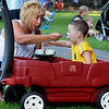 Salem:<br /> Karen Rowe and her grandson, Alexavier Saldane, 2, enjoy their ice cream at the Ice Scream Bowl on the Salem Common. Families sampled flavors from various North Shore ice cream parlors. The event is run by Salem Main Streets and is part of Heritage Days.<br /> Photo by Ken Yuszkus/Salem News, Tuesday August 10, 2010.