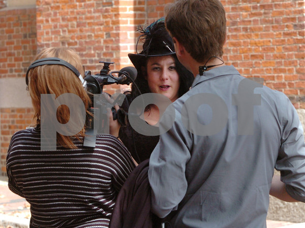 """Salem:<br /> Leanne Marrama is shot outside the Old Town Hall. Leanne Marrama is the main character in the upcoming episode of """"What Not To Wear"""" appearing on the TLC network.<br /> Photo by Ken Yuszkus/Salem News, Wednesday, September 9, 2009."""