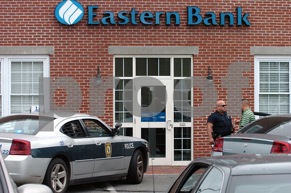 Salem:<br /> The scene outside the Eastern Bank on Congress Street right after the morning bank robbery.<br /> Photo by Ken Yuszkus/Salem News, Thursday, June 25, 2009.