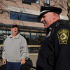 Peabody:<br /> Bob Mahoney, Peabody police officer, speaks with Duke Girard, and othr residents of the Peabody House, who are sitting in front of the Peabody House. The Peabody House is one area patroled by officer Bob Mahoney.<br /> Photo by Ken Yuszkus/Salem News, Wednesday November 18, 2009.