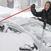 Beverly:<br /> Nancy Hayes uses a broom to clean off her cars during the snowstorm on Monday morning.<br /> Photo by Ken Yuszkus/Salem,  News, Monday,  December 27, 2010.