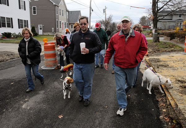 Danvers:<br /> Leading the group of walkers are, from left, Amy Goodnow, Gardner Trask, selectman, and Mark Lettich as they walk in the neighborhood affected by the explosion on the 3-year anniversary of the explosion.<br /> Photo by Ken Yuszkus/Salem News, Sunday November 22, 2009.