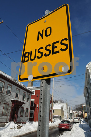 """Salem:<br /> Sign on Daniels Street at Derby Street In front of In A Pig's Eye restaurant. The sign reads """"No busses"""", which means no kissing.<br /> Photo by Ken Yuszkus/Salem News, Tuesday March 3, 2009."""
