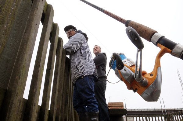 Beverly:<br /> Kevin Hoang, left, and Anthony Sheehan, both of Danvers, wait for fish to bite their baited lines on a gray afternoon at the Beverly pier.<br /> Photo by Ken Yuszkus/Salem News, Monday, April 23, 2012.