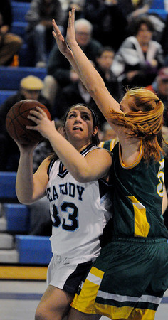 Peabody:<br /> Peabody's Carli Giacchino, left, tries to see through the coverage by the Lynn Classical player for a shot  during the Peabody High girls basketball game vs. Lynn Classical at Peabody.<br /> Photo by Ken Yuszkus/Salem,  News, Tuesday,  December 14, 2010.